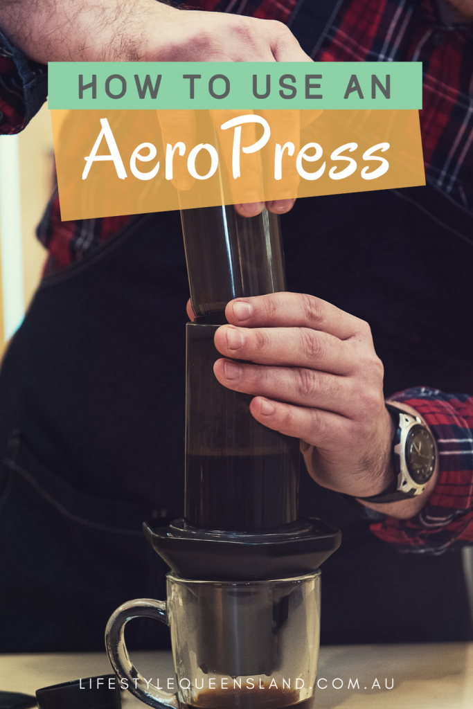 how to use aeropress coffee makers pin image of a man plunging an aeropress